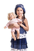 The small beautiful girl with a doll — Stock Photo