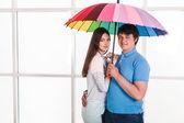 Couple under a umbrella — Stock Photo