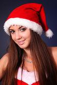 Güzel bir kadın Noel Noel Baba — Stok fotoğraf