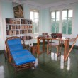 The studio and library and the typewriter on the desk of Hernest Hamingway in the tower of the Finca Vigia . Finca Vigia was the home of Hernest Hemingway in the suburb of the Havana, Cuba. Now the Finca Vigia is a museum — Zdjęcie stockowe #44121191