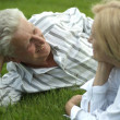 Beautiful Caucasian elderly couple lying — Stock Photo