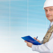 Intelligent man working in the construction helmet - Stock Photo