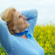 Happy old woman is enjoying the fresh air — Stock Photo