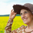 Happy old woman is enjoying the air - Stock Photo