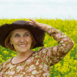 Stock Photo: Interesting old womis enjoying fresh air