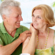 Stock Photo: Beauteous old couple at the resort