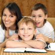 Stock Photo: Bliss charming mom and sons sitting