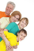 Grote familie in heldere t-shirts — Stockfoto