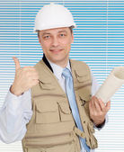 Successful male working in the construction helmet — Stock Photo
