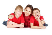 Woman and her sons in a red sweaters — Stockfoto
