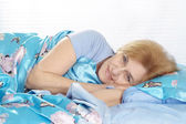 Pretty woman is resting at home — Stock Photo