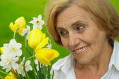 Sympathetic woman enjoys nature — Stock Photo