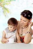 Nice young woman with kid — Stock Photo