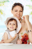 Pretty young woman with kid — Stock Photo