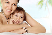 Fine young woman with kid — Stock Photo