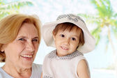 Elderly woman with kid — Stock Photo