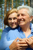Smiling older are enjoying the fresh air — Stock Photo