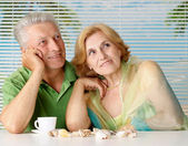Cool old couple at the resort — Stock Photo