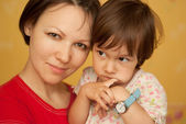Young woman hugging baby — Stock Photo