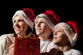 Family in santa hats — Stock Photo