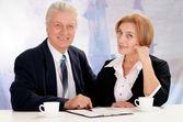 Bir iş kadını ile işadamı — Stok fotoğraf