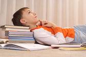 Beauteous boy does homework — Stock Photo