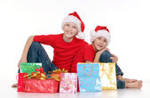 Happy children with gifts — Стоковое фото