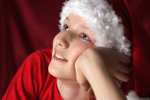 Happy kid in santa hat — Stock Photo