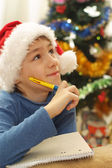 Boy in the Christmas hat — Photo