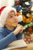 圣诞帽子的男孩 — 图库照片