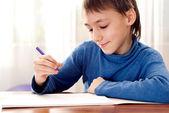 Boy makes homework — Foto de Stock