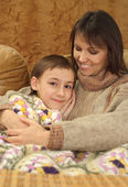 Beautiful charming Caucasian mama with her son — Stock Photo