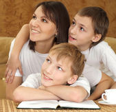 Mercy charming mom and sons sitting — Stock Photo