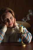 Beautiful aged woman sitting — ストック写真