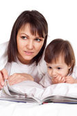 A beautiful nice Caucasian mother with her daughter lying with a — Stock Photo