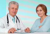 Pleasant doctor and his patient — Stock Photo