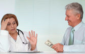 Honest doctor and her patient — Stock Photo