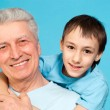 Caucasian old man with a lad — Stock Photo