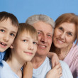 A happy family of four — Stock Photo #12842356