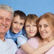 A happy family of four — Stock Photo #12842365