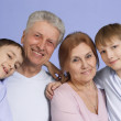 A happy family of four — Stock Photo