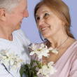 Stock Photo: Happy Caucasielderly stand together with flower