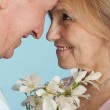 Happy Caucasian elderly stand together with the flower — Stock Photo #12842411