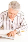 Reading the newspaper eldery senior — Stock Photo