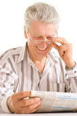 Reading the news old senior — Stock Photo