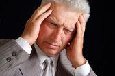 Sad elderly man in suit — Stock Photo