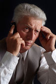 Worried mature man in suit — Stock Photo