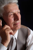 Handsome mature man in suit — Stock Photo