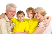 Grandparents with their cute grandchildren — Stock Photo