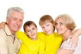 Grandparents with their lovely grandchildren — Stock Photo